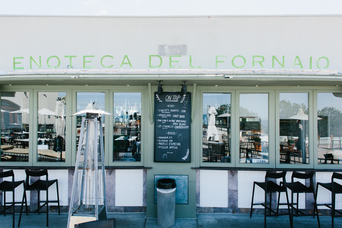 Enoteca Del Fornaio with sign, chair, and outdoors