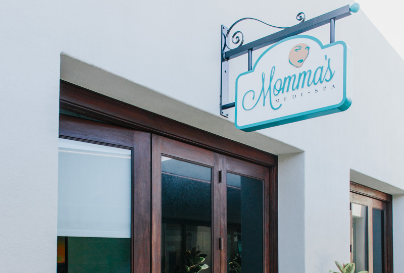 Mama's Medi Spa with closed door and blue sign