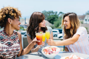 Pictures of 3 women having mimosas in Del Mar