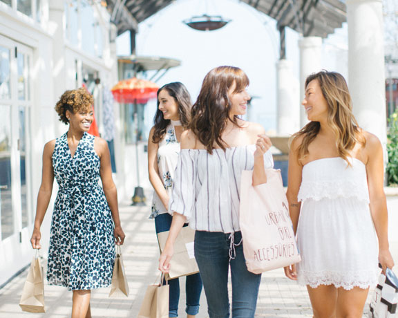 girls walking through Del Mar Plaza with shopping bags