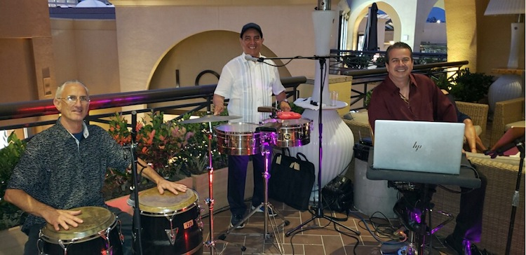 Son y Clave band members in front of their instruments smiling