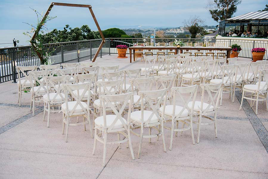 rows of chairs facing an ocean view at del mar plaza